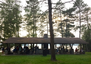 Program participants, community members and leaders relaxing at the Dawson Trail Campground at French Lake in Quetico Park during the Quetico Foundation sponsored community BBQ