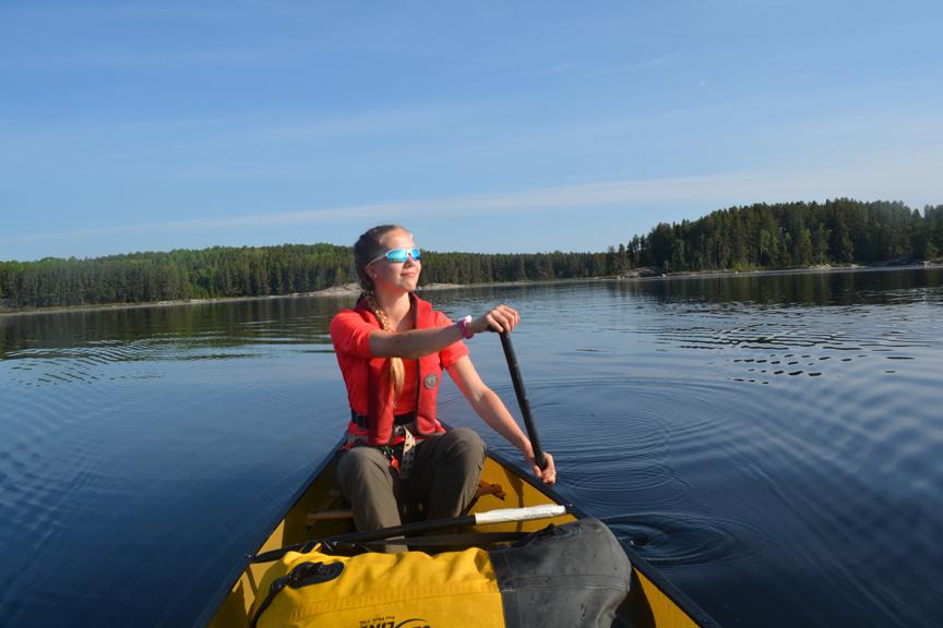 Kiara paddling Sturgeon Lake. Credit: Hannah Koslowsky