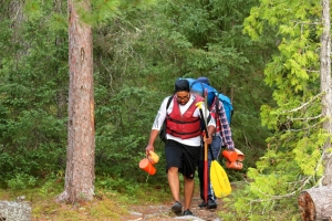 Portaging along a Quetico lake-to-lake trail.