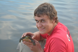 "Ty and western painted turtle or ""Hey, photograph me with this great student from the Student Summer Research Program team"""