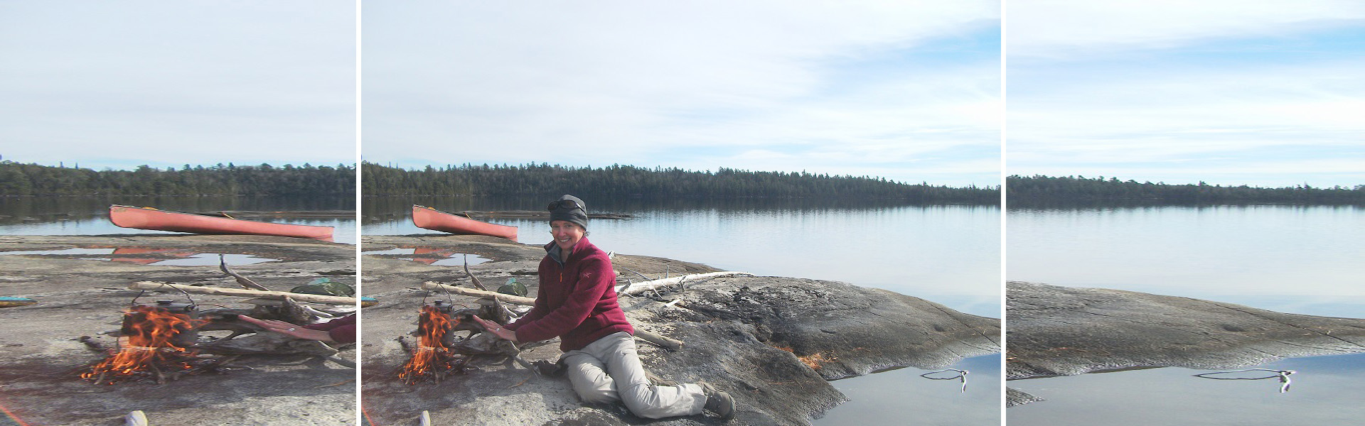 Photograph of Lise Sorenson sitting next to a campfire with a red canoe in the background
